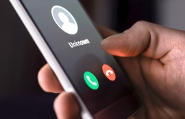 Phone call from unknown number late at night. Scam, fraud or phishing with smartphone concept. Prank caller, scammer or stranger. Man answering to incoming call. Hoax person with fake identity.